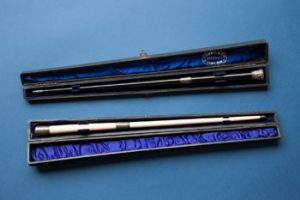 Two ceremonial batons presented to George