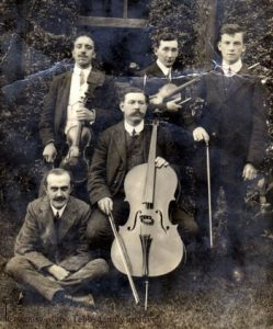George Tebbs, with cello, and friends