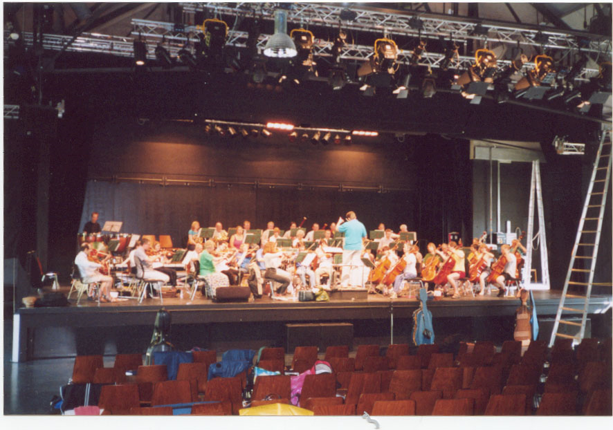 The orchestra rehearsing in the heat